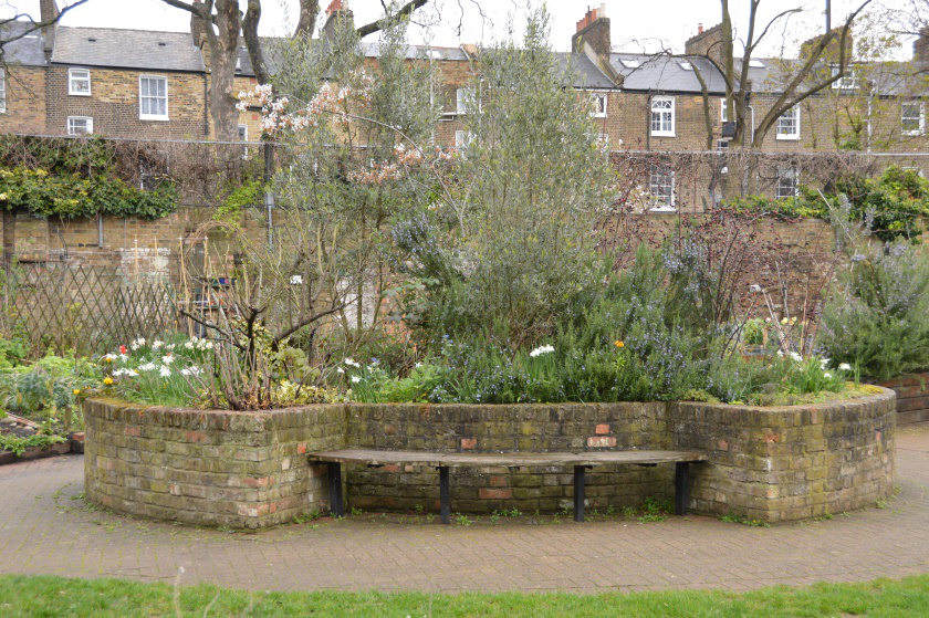 A brick-built raised bed forming the centrepiece of the garden.